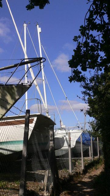 Narrow footpath by boatyard on Hayling island