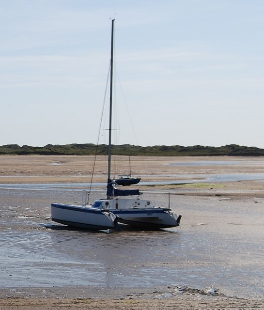 Catamaran on the mudflats of the River Mite, Ravenglass