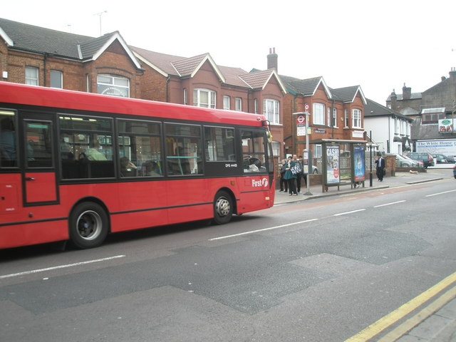 Bus approaching a stop opposite the Methodist Centre