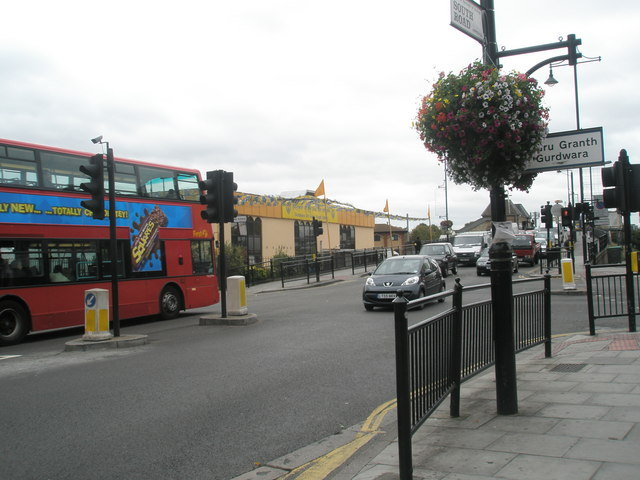 Bus passing the crossroads by the Gurdwara