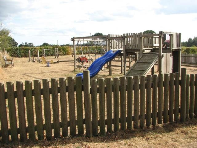 Children's playground beside village hall