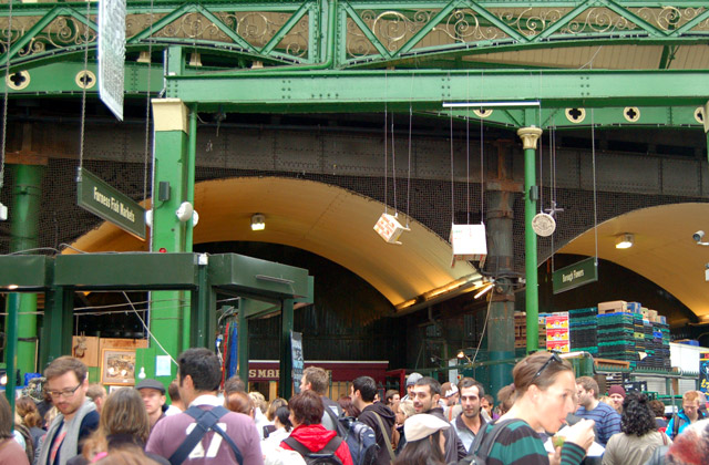 Crowds under ornate roof, Borough market, south London