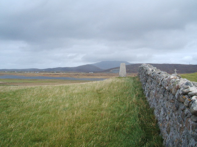 Trig point , wall and cross at  Cladh Hallan