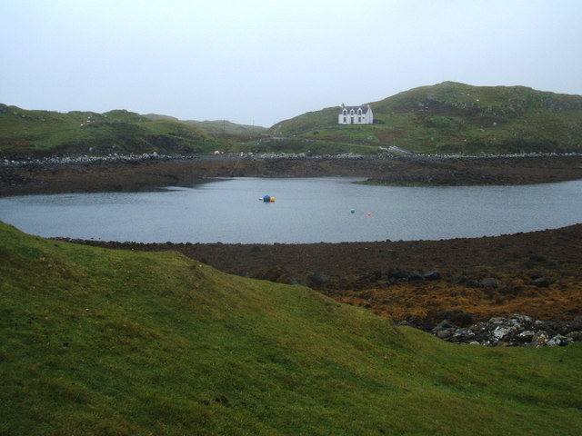 White house and buoys in Borosdale Bay