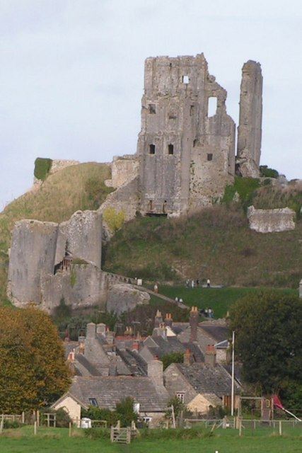 The ruins of Corfe Castle rising behind the village