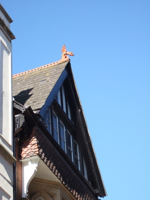 A dragon on a shop roof in Exeter