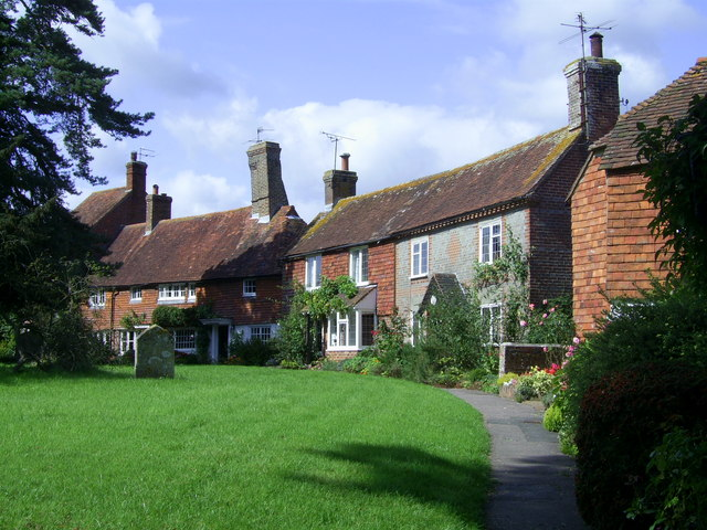 Cottages surrounding the oval churchyard at Hellingly, East Sussex
