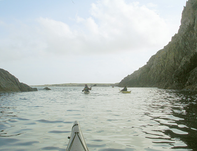 Paddling out of a cave below the Heights of Ramnageo