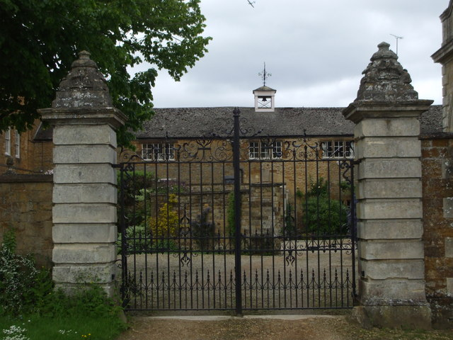 Iron gates to restored house in Sandford St. Mary
