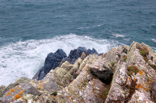 Sea breaking on rocks at Pen y Cyfrwy headland