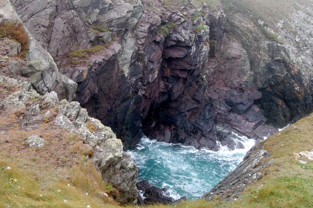 Sea in a narrow inlet at Pen y Cyfrwy headland