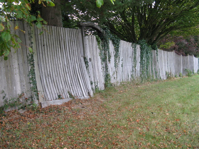 Old oak fencing and gate bordering houses at Poynings