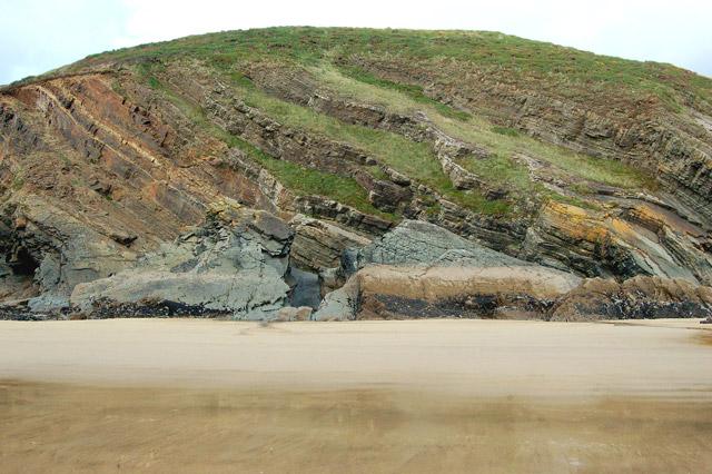 Inclined strata above shoreline, Pwll March, Newgale