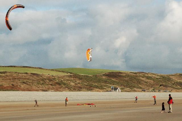 Kite-skaters (landboarders) congregate on Newgale beach