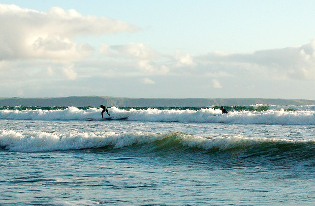 Solitary surfer at Newgale beach