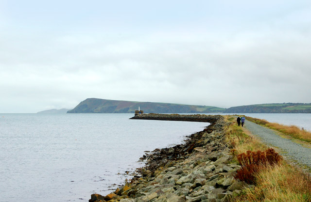 Fishguard harbour south breakwater with Dinas Head in the distance