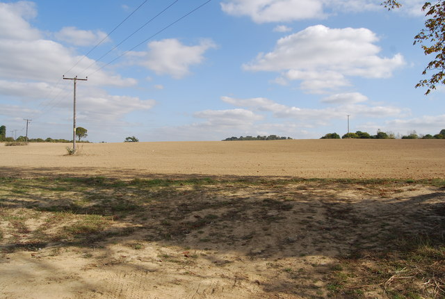 Large ploughed field by Lower Haysden Lane