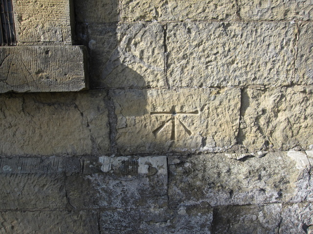 1GL bench mark and bolt on the church of St John the Baptist, East Ayton
