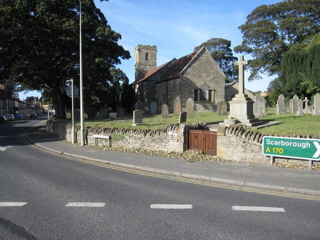 The church of St John the Baptist and the war memorial