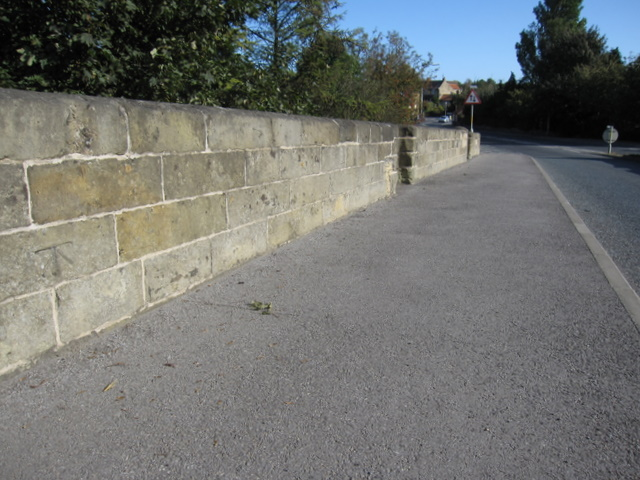 Looking north east on Ayton bridge, and a bench mark