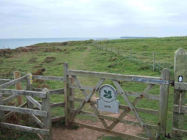 Coastal footpath entering National Trust land