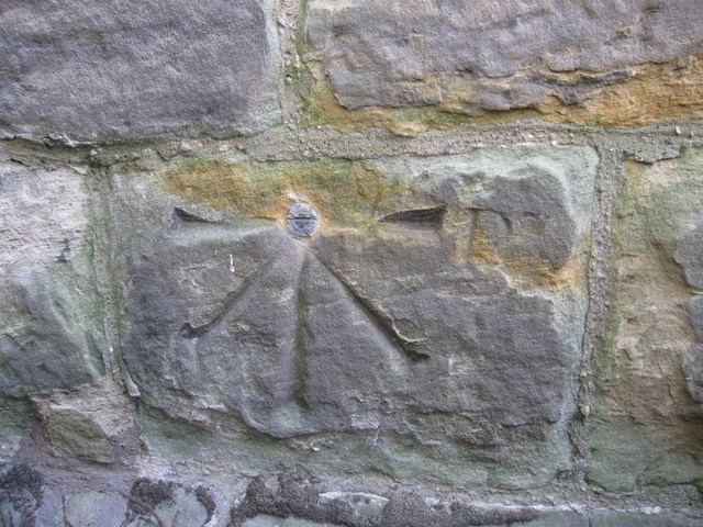 1GL bench mark and bolt on the church of St John the Baptist, Cayton