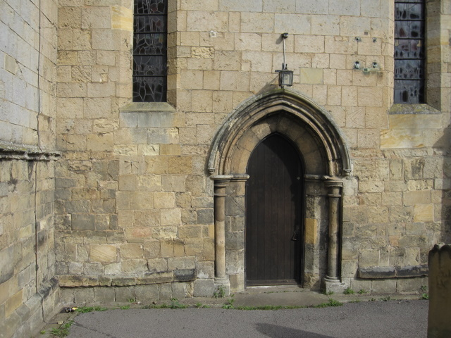 South door of St Oswald's, and a bench mark