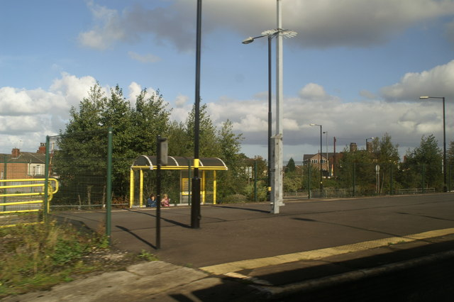 Transport interchange at St Helens Junction, as seen from the 12.01 from Newton-le-Willows