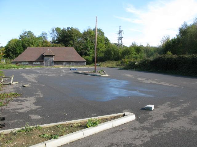 Disused car park and barn near Peene