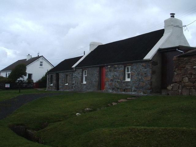Cottage with red door, Port Henderson