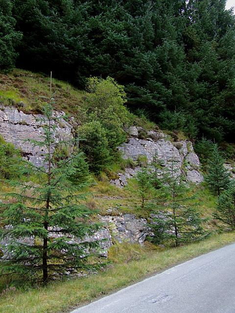 Craggy hillside and bridleway into Tywi Forest, by Llyn Brianne
