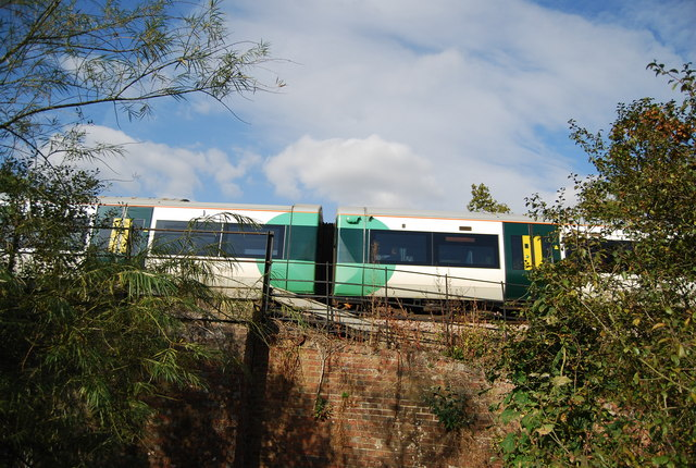 Train crosses the railway bridge across the Shallows, Haysden Country Park