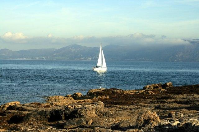 Yacht sails past Trwyn Du Point