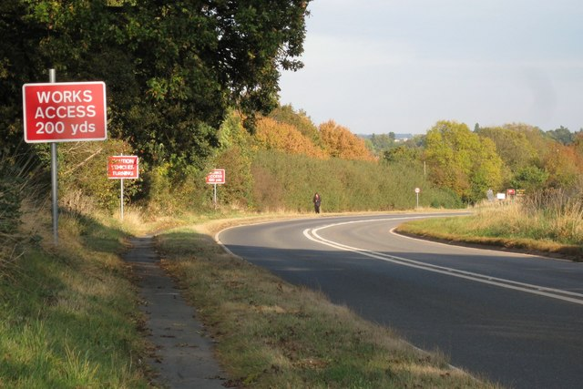 Three red signs, A4189 Hampton Road near Warwick