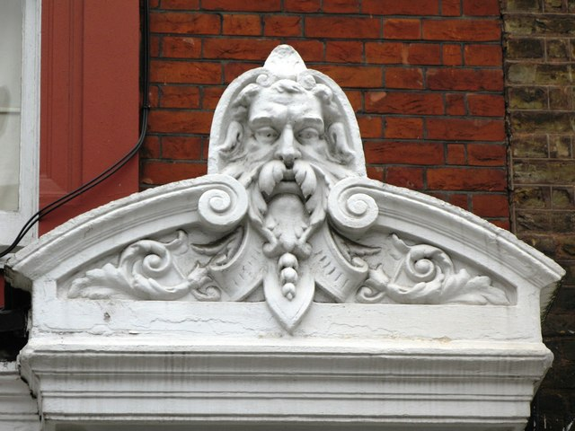 Hirsute man on a building in Chiltern Street, W1