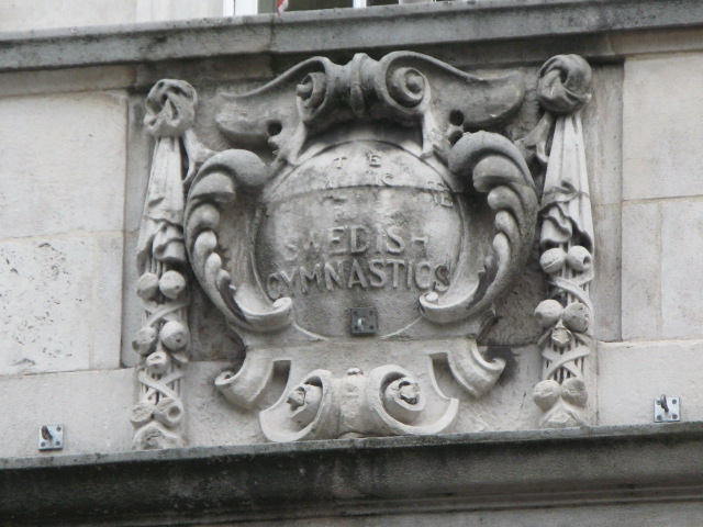 Plaque above the entrance to the Hellenic Centre, Paddington Street, W1