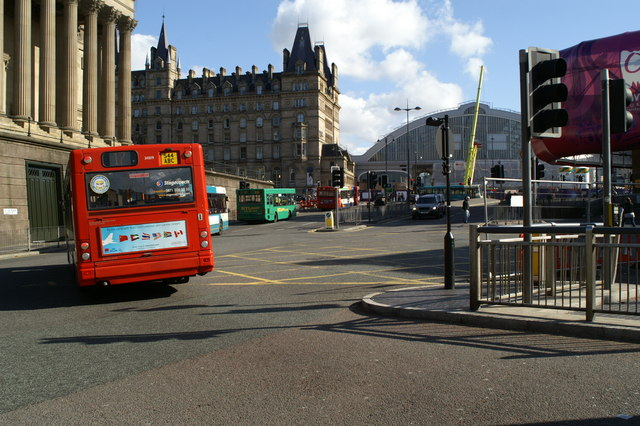 Buses in a variety of liveries leaving Queens Square Bus Station