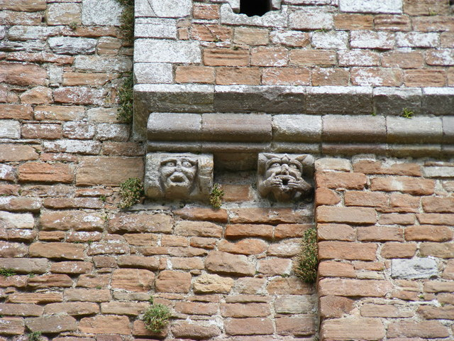 Gargoyles on wall at Brougham Castle