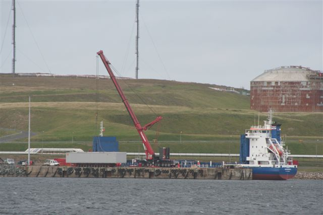 Cargo boat Sardinia at construction jetty
