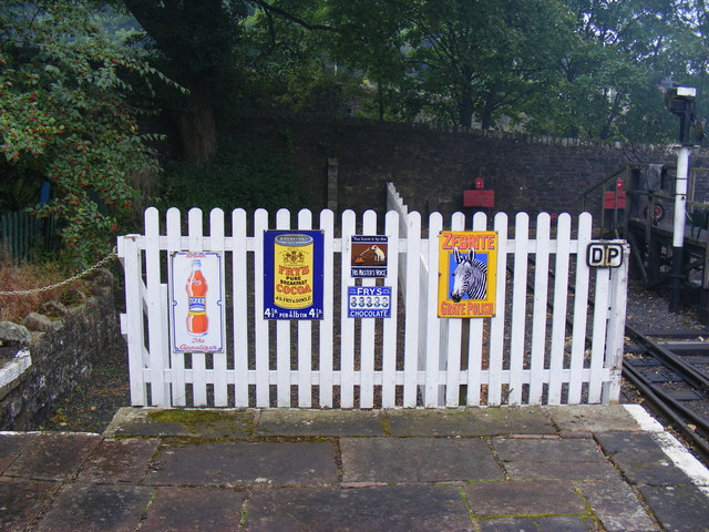 Advertising signs on platform at Alston station