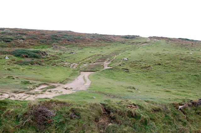 Coastpath climbing away west of Porthmelgan cove