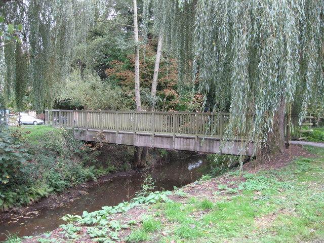 Footbridge over brook leading to Woking Park