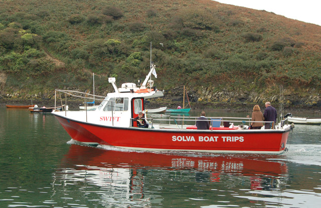 Passenger trip boat heading into Solva harbour