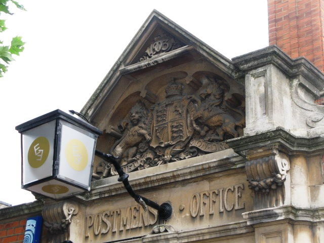 Edward VII crest above the entrance to the (former) Sorting Office, Leighton Road, NW5