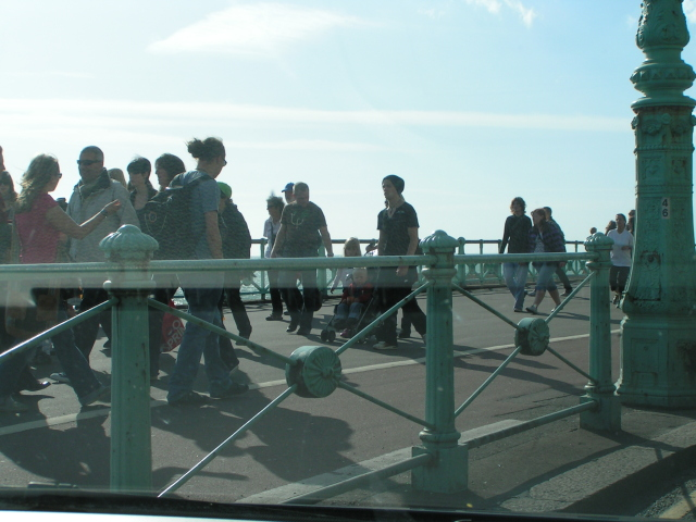 Pedestrians on Brighton sea front