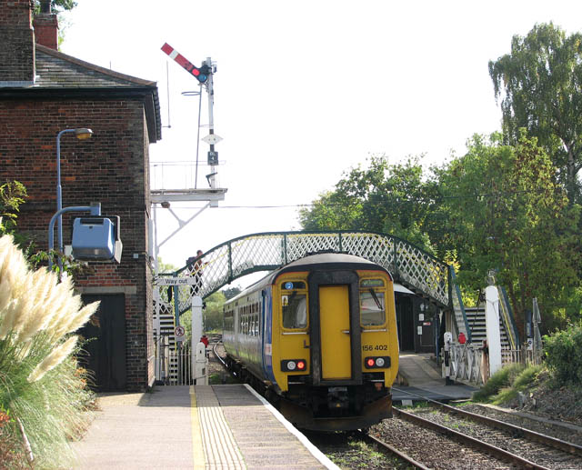 Unit 156 402 leaving Brundall station
