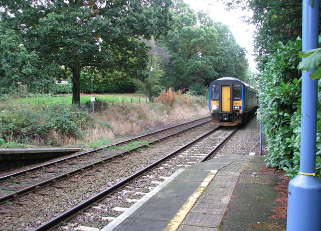 Norwich-bound train passing Brundall Gardens station