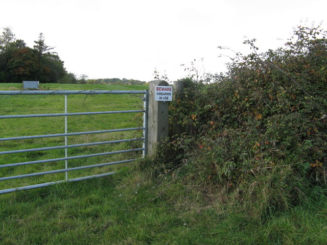Warning sign at junction of footpath with bridleway