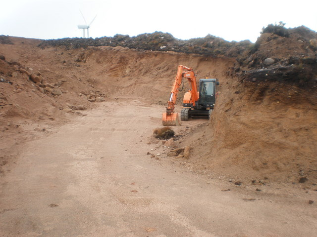 Digger in new quarry for new road