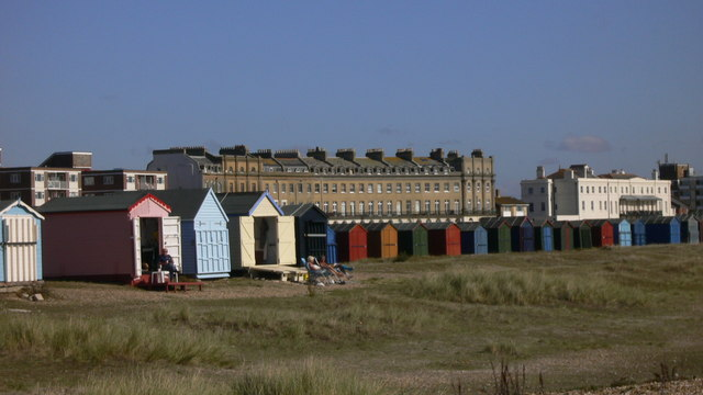 Beach huts at South Hayling with Norfolk Crescent beyond